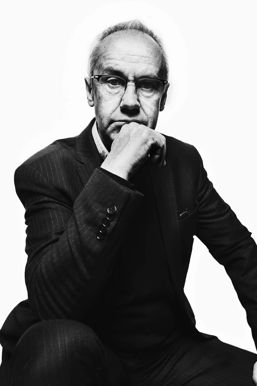 Portrait Series of Daniel Cati, black and white portrait of man with glasses