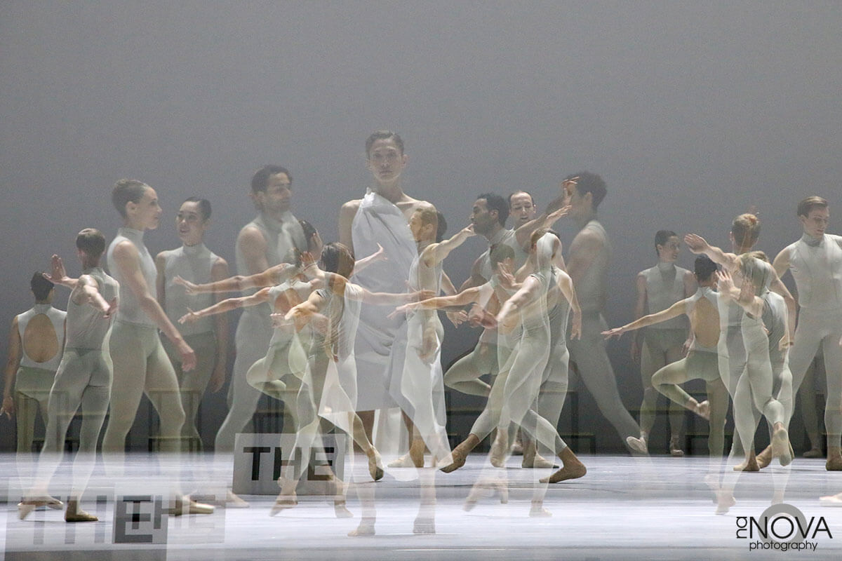 A double exposure image showing a group of dancers on a stage.
