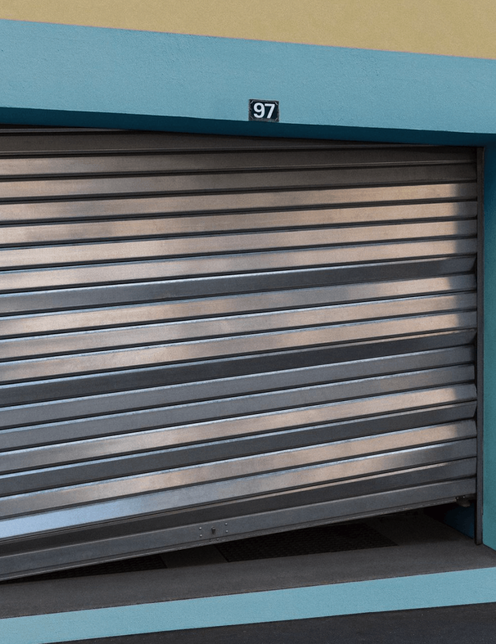 Half-open garage door.