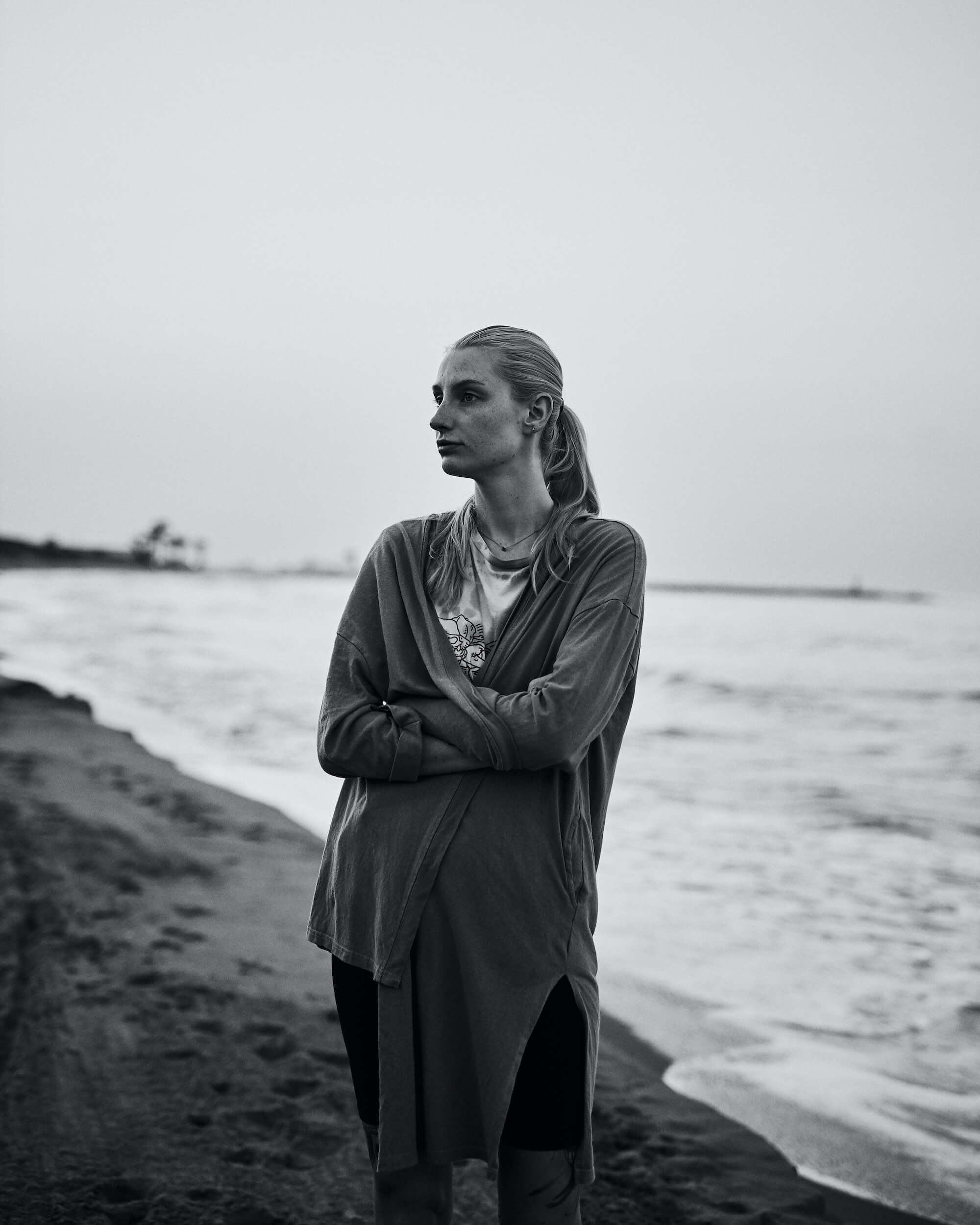 Portrait Series of Daniel Cati, black and white portrait of woman at the beach