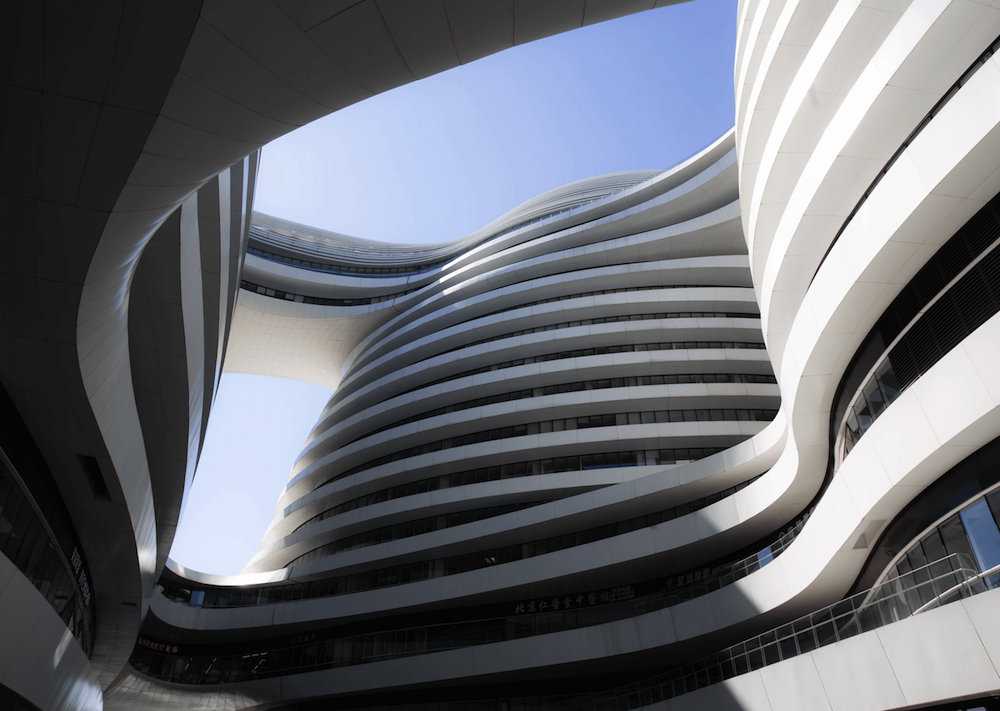 Symmetrical, curved facade of a modernist building.