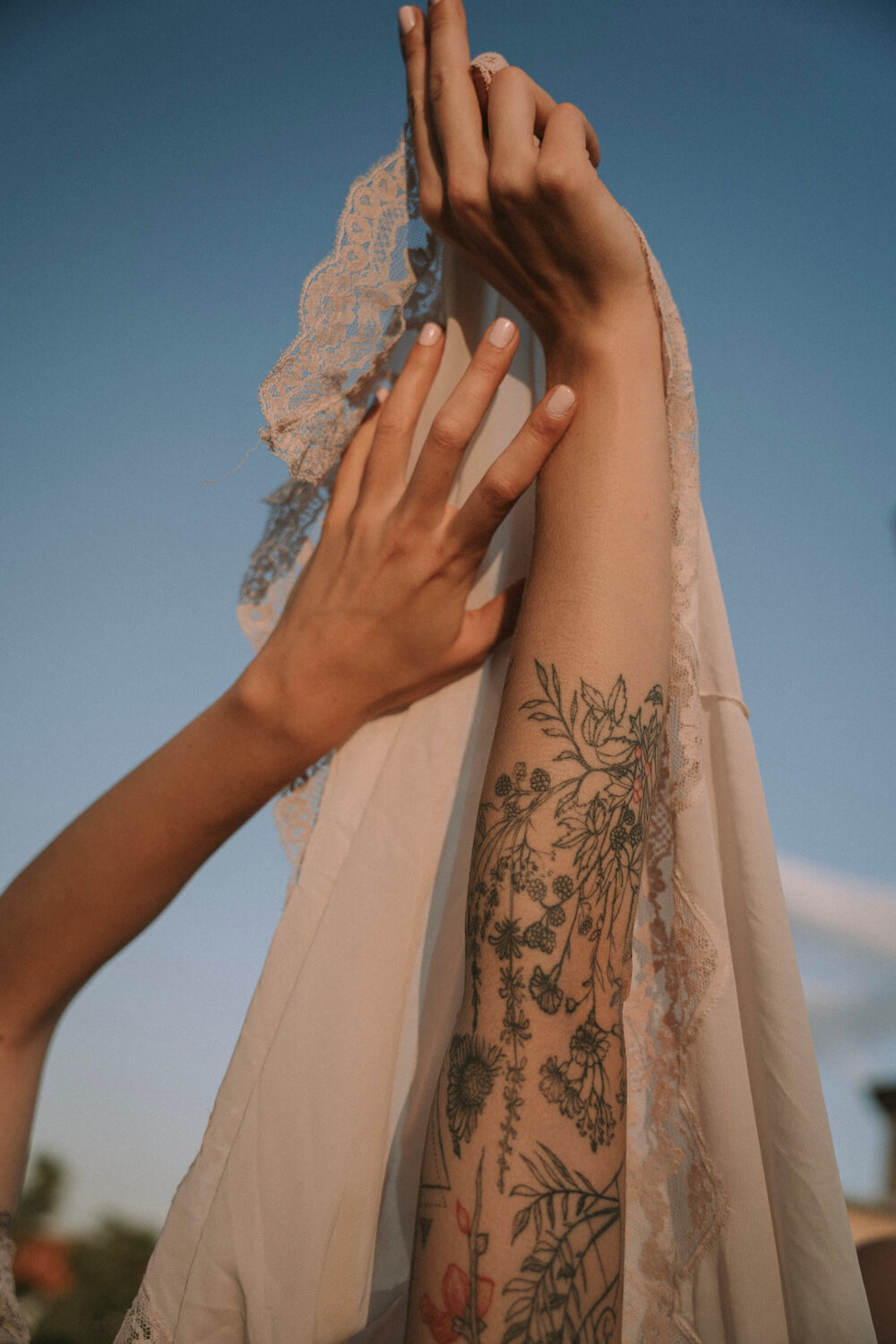 Hands with tattoos and embroided fabric in Berlin by photographer Krystsina Shyla