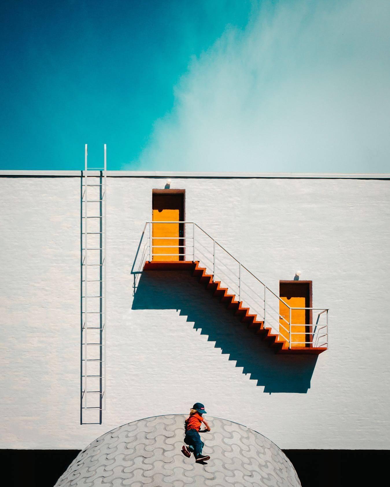 White building, orange stairs