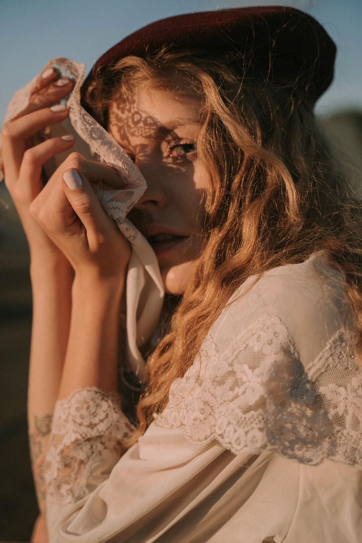 Portrait of girl with sunlight boheme style by photographer Krystsina Shyla