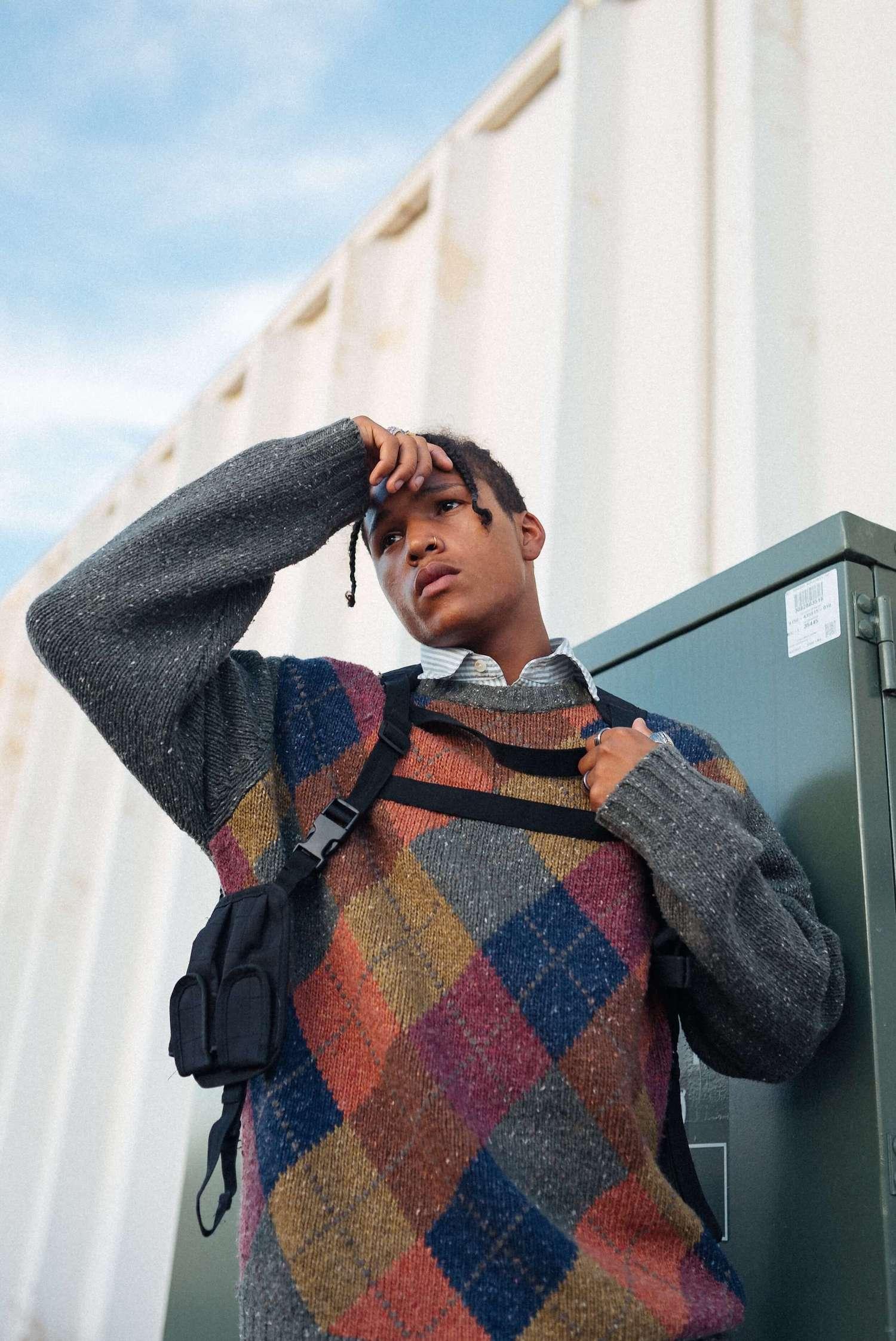 Male model wearing a diamonds jumper.