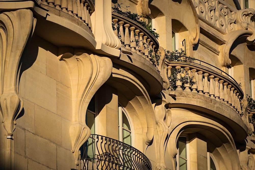 Facade of a building with Romanesque-style balconies.