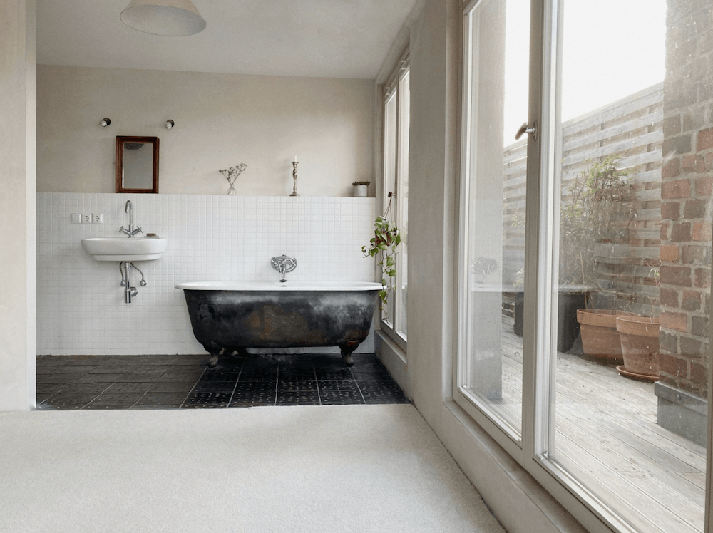Bathroom of an Artist loft with huge staircase available for rent for your next film production in Berlin, Germany. Minimalist and unique interior design