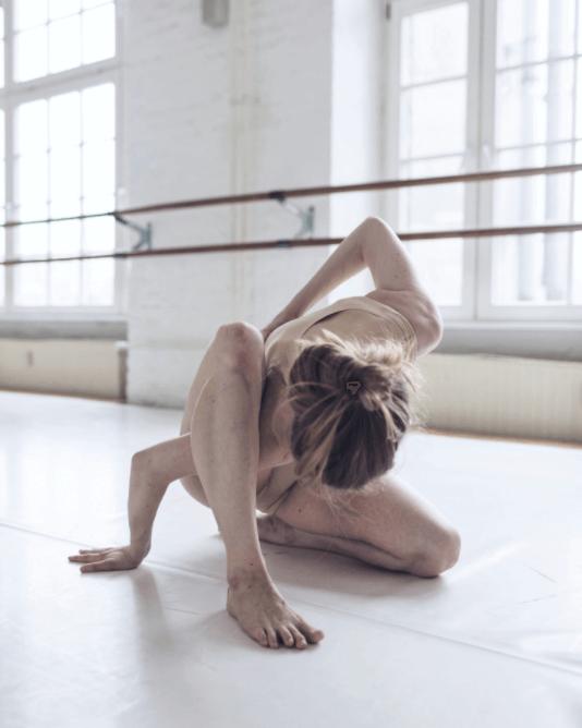 A ballet dancer doing a contortion pose.
