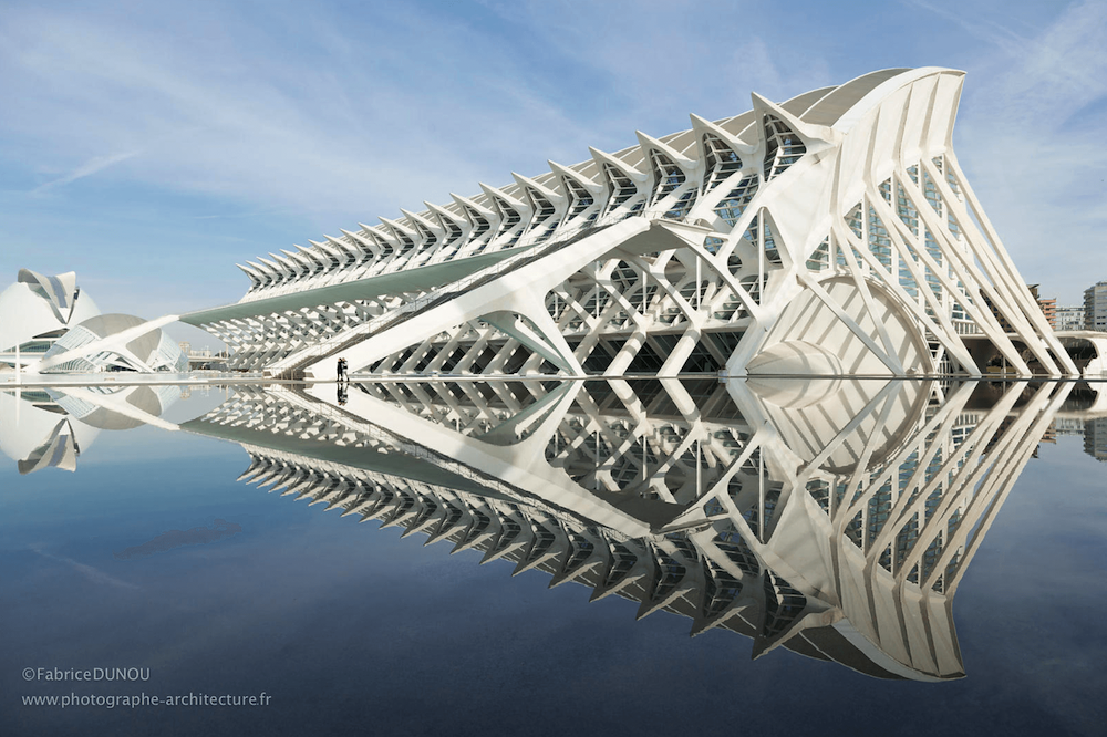 Modernist architectural structure reflected in an artificial lake.