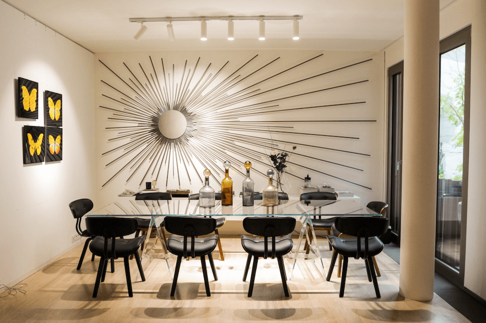 Dining room of a modern design apartment in architect building, available to rent as a film location in Berlin, Germany.