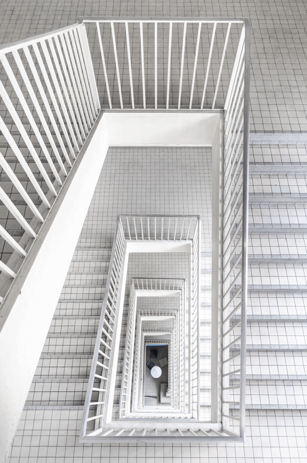 White tiled stairs inside a building.