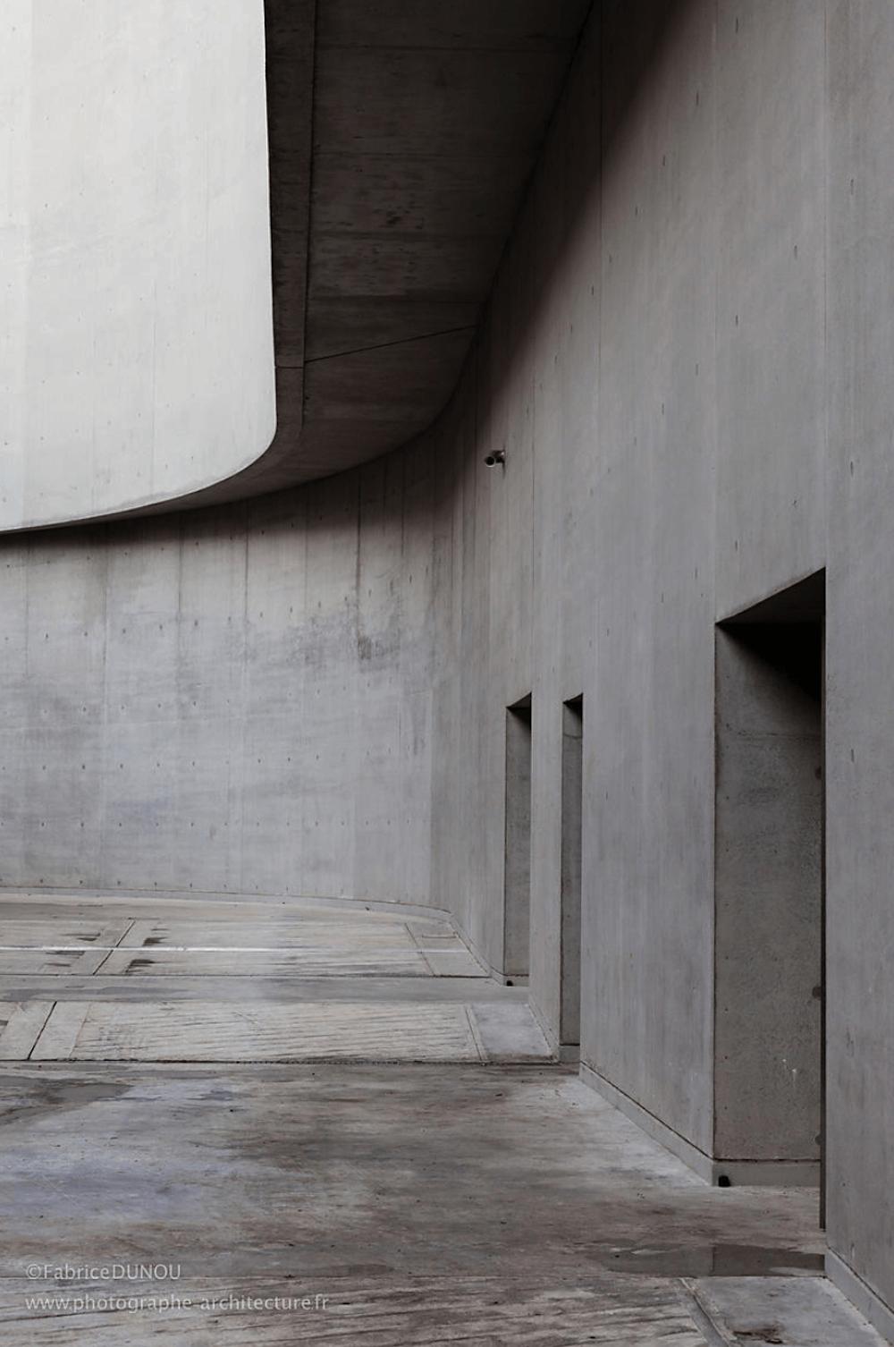 Interior of a grey minimalist building.