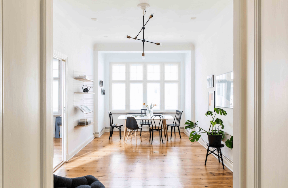 Dining room of a minimalist apartment for rent for your next film production in Berlin, Germany. Minimalist and unique interior design