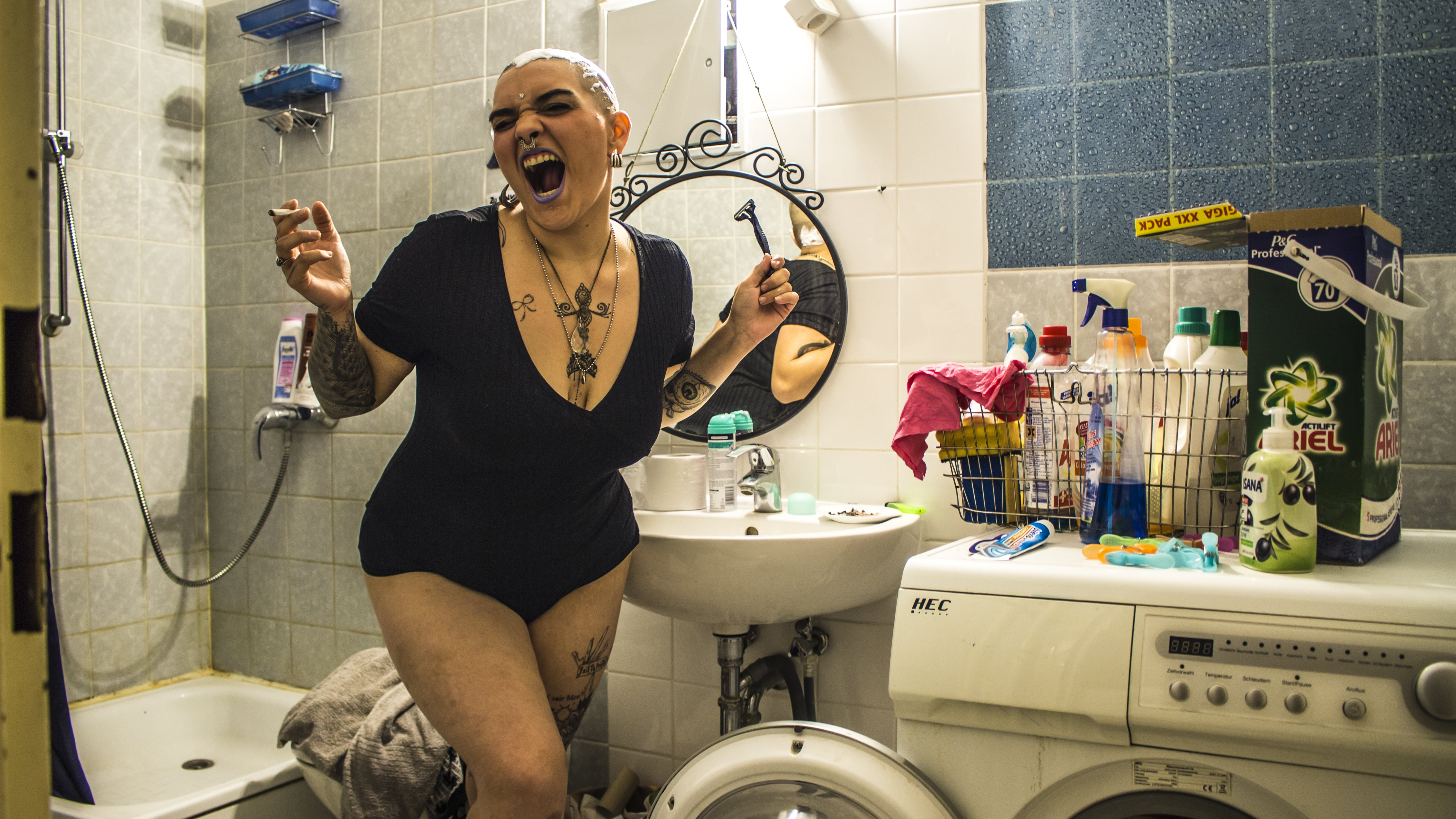 Woman smoking in a bathroom, photograph of Paco Pennino who won the Beazy Architecture contest