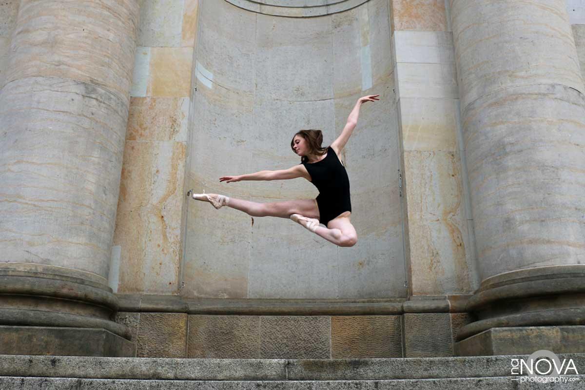 A ballet dancer doing a dance leap.
