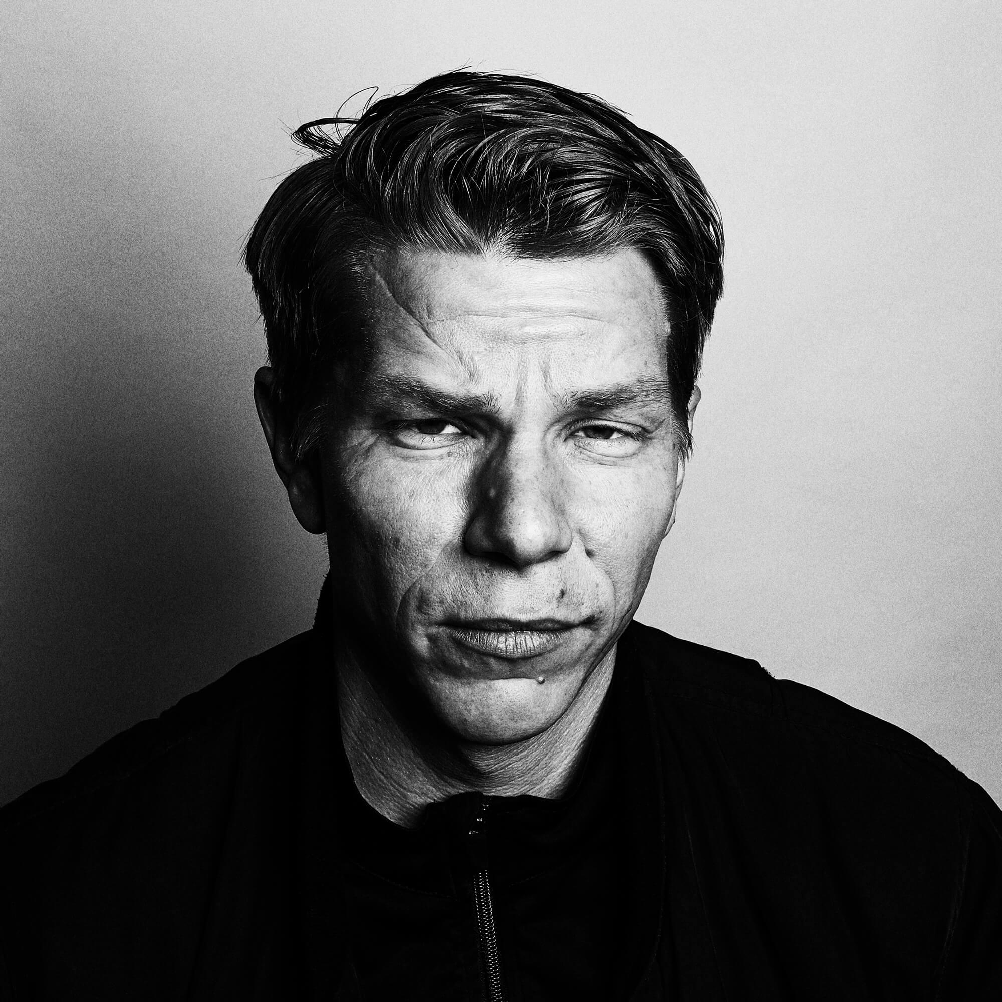 Portrait Series of Daniel Cati, black and white portrait of charismatic man