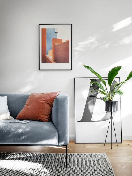 Set design of a couch and bright room for a photoshoot