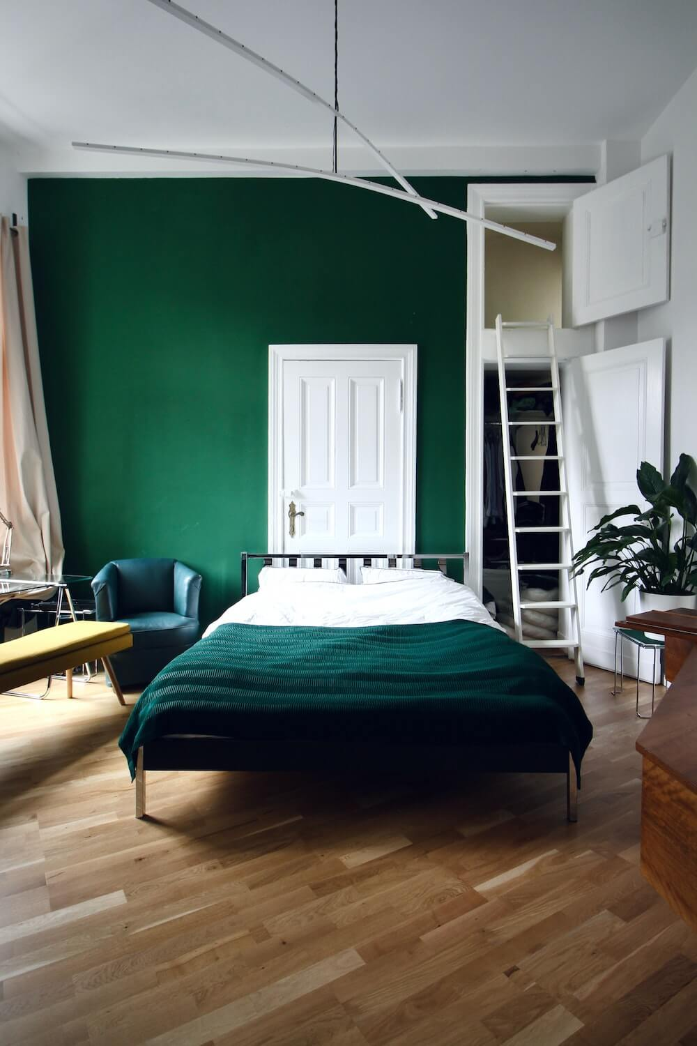 Interior and real estate Photography of a green bedroom with large hanging lamps