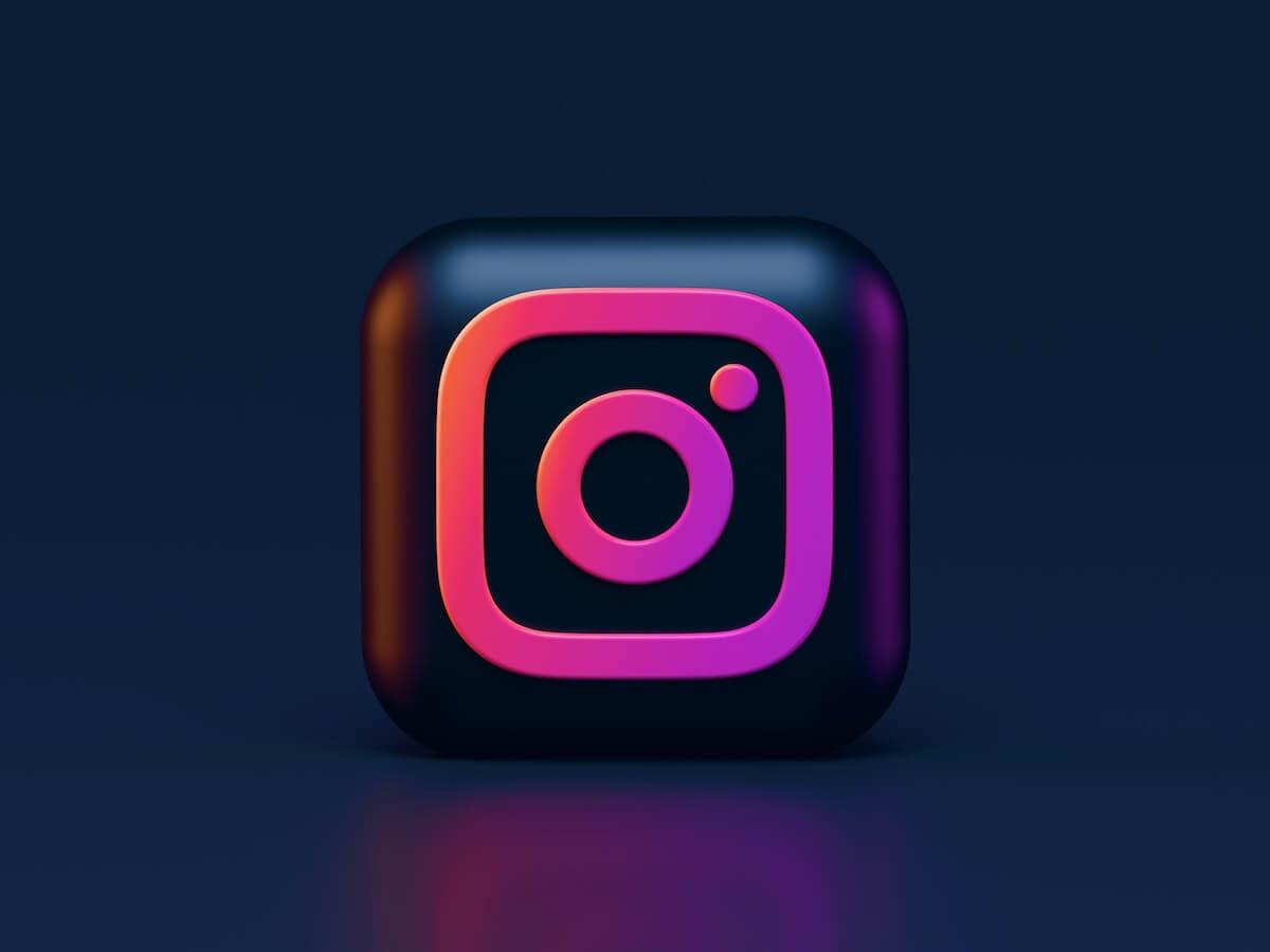 Instagram logo on dark background.