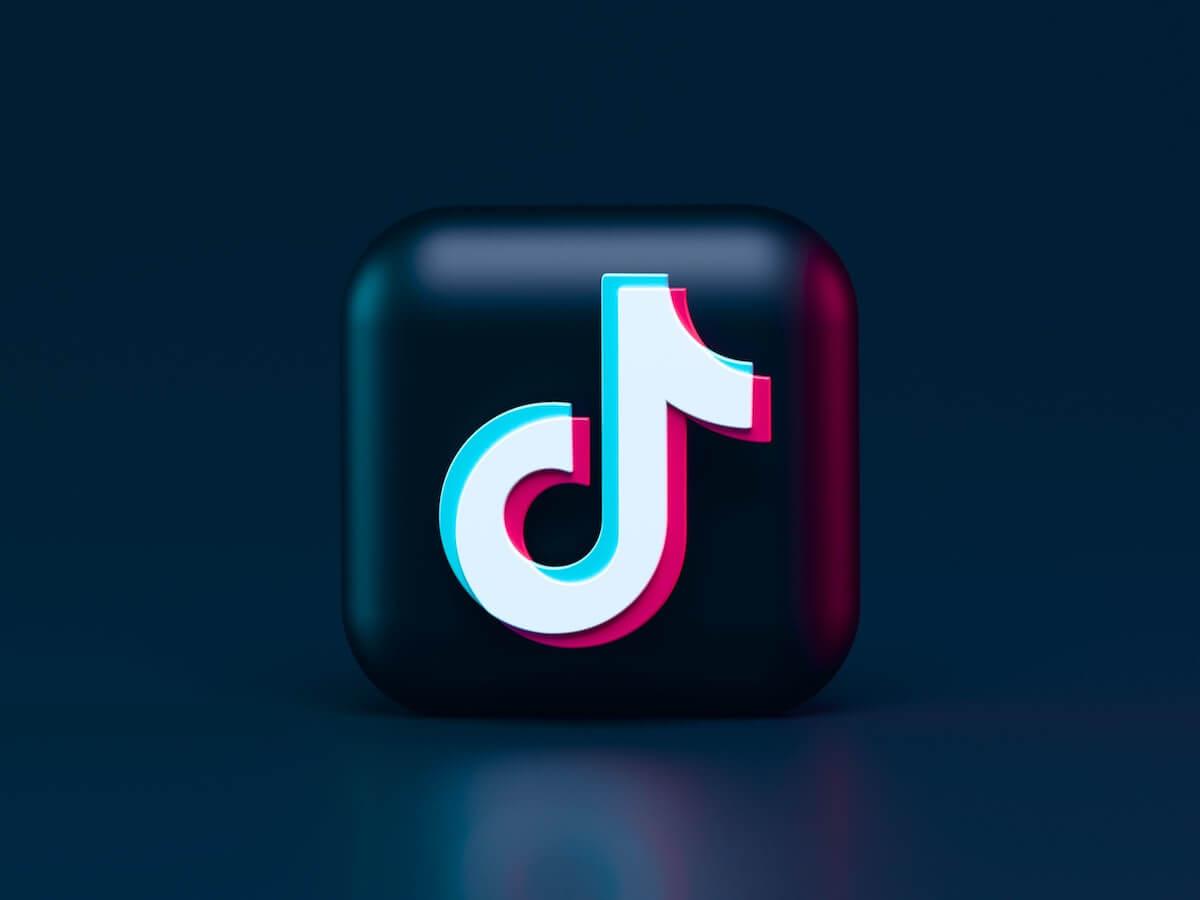 TikTok logo on dark background.