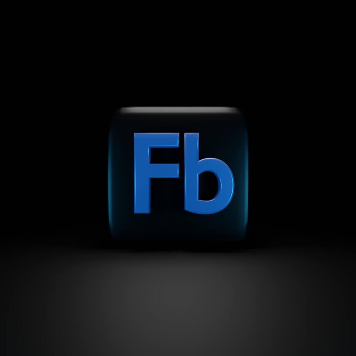 Facebook logo on dark background.