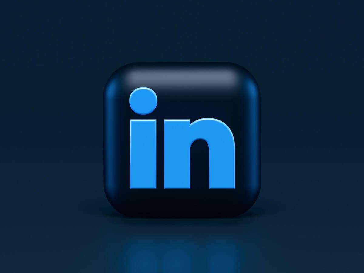 LinkedIn logo on dark background.