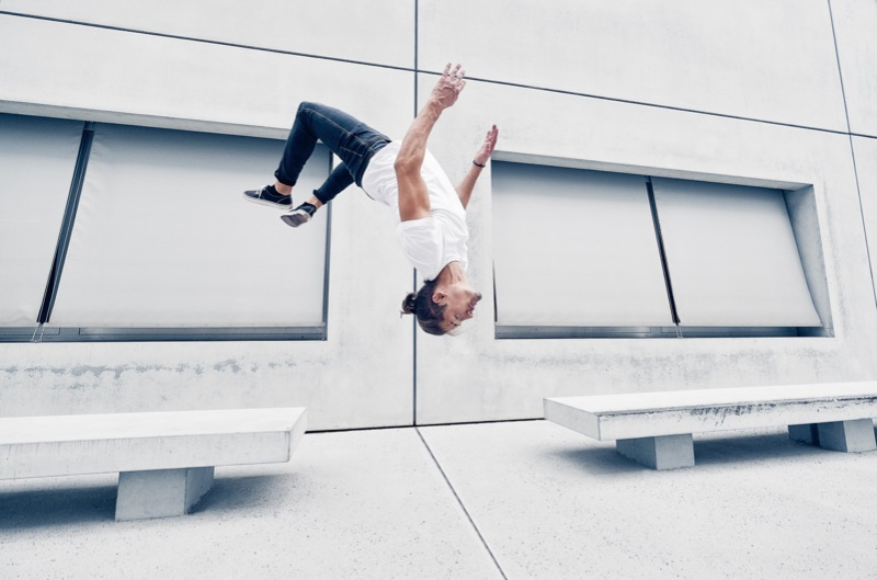 Parkour Athlete photoshoot in Berlin, Germany, doing a backflip