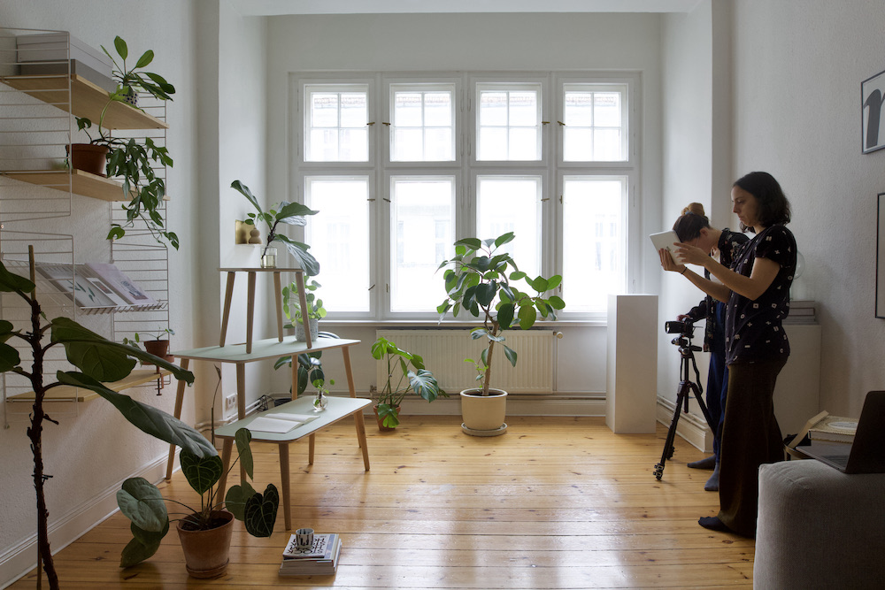 Project managers on set for a photoshoot of a furniture brand in a bright flat