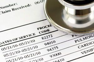 Medicare claim with procedure codes and stethoscope in top right corner of image