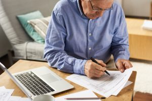 Arizona man is filling out the form for automatic payments with Medicare