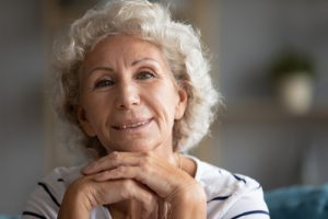 Elderly Arizona woman happy with her current Medicare insurance plan