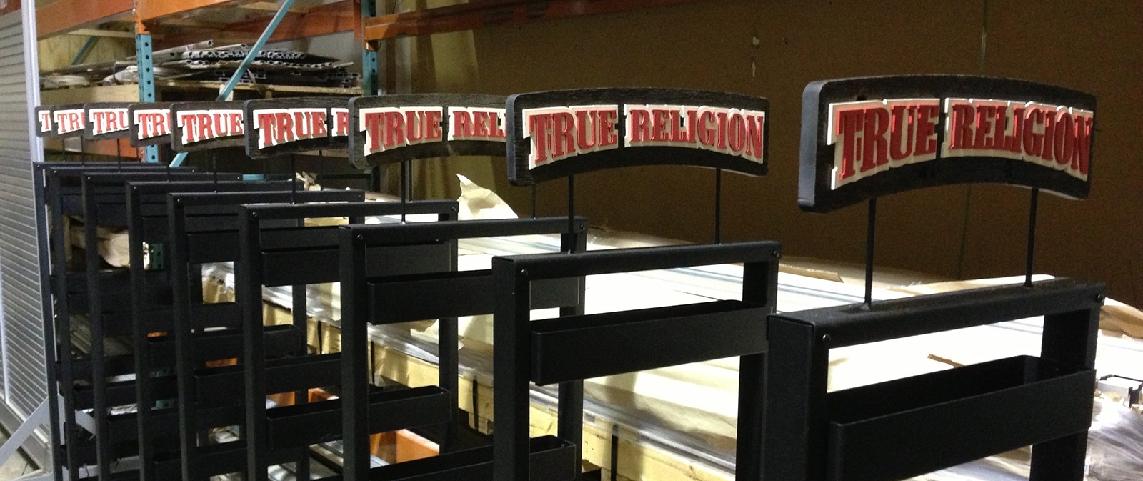 rows of metal signage that says true religion