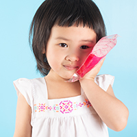 child holding ice pack on cheek