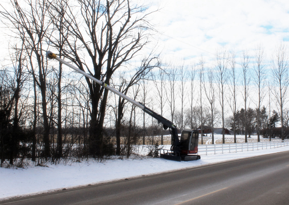 Kwik trim is working alongside a gravel road to provide tree trimming & ROW (right-of-way) maintenance for cities in MN
