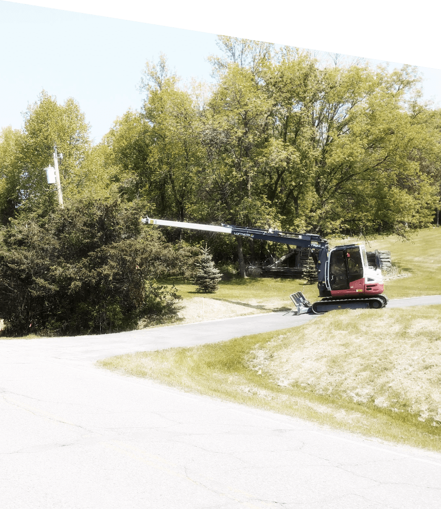 Kwik Trimmer parked alongside trail to trim large trees & bushes in public Minnesota park for municipalities