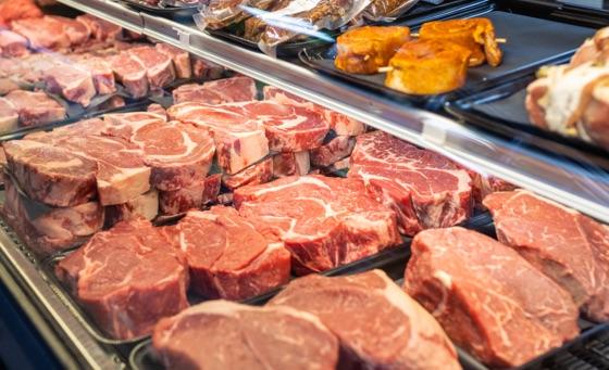 Fresh cut Dakota Butcher steaks behind glass