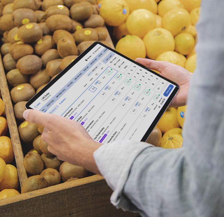 iPad in hands in Produce Department