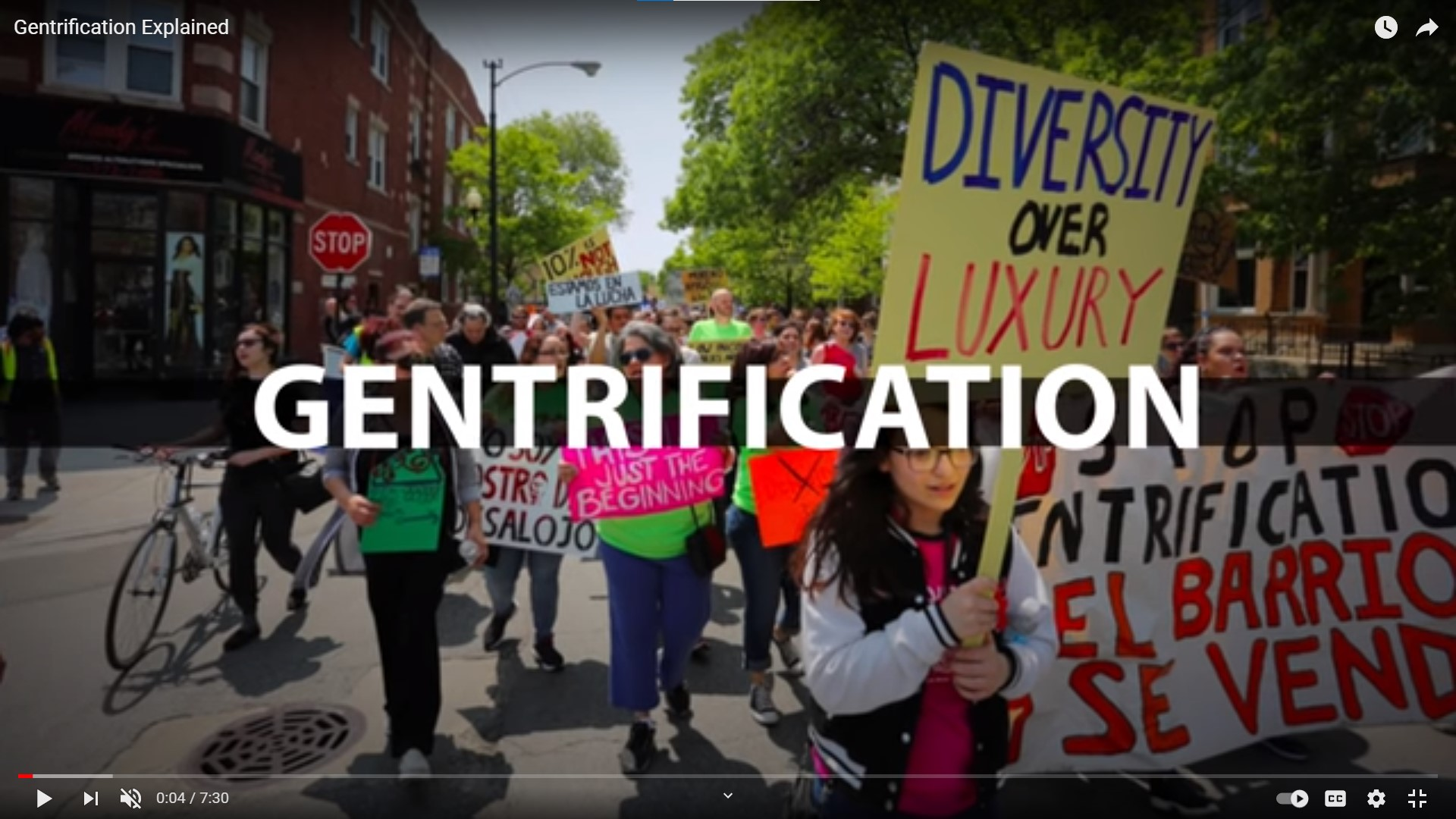 Image of people marching in protest against gentrification.