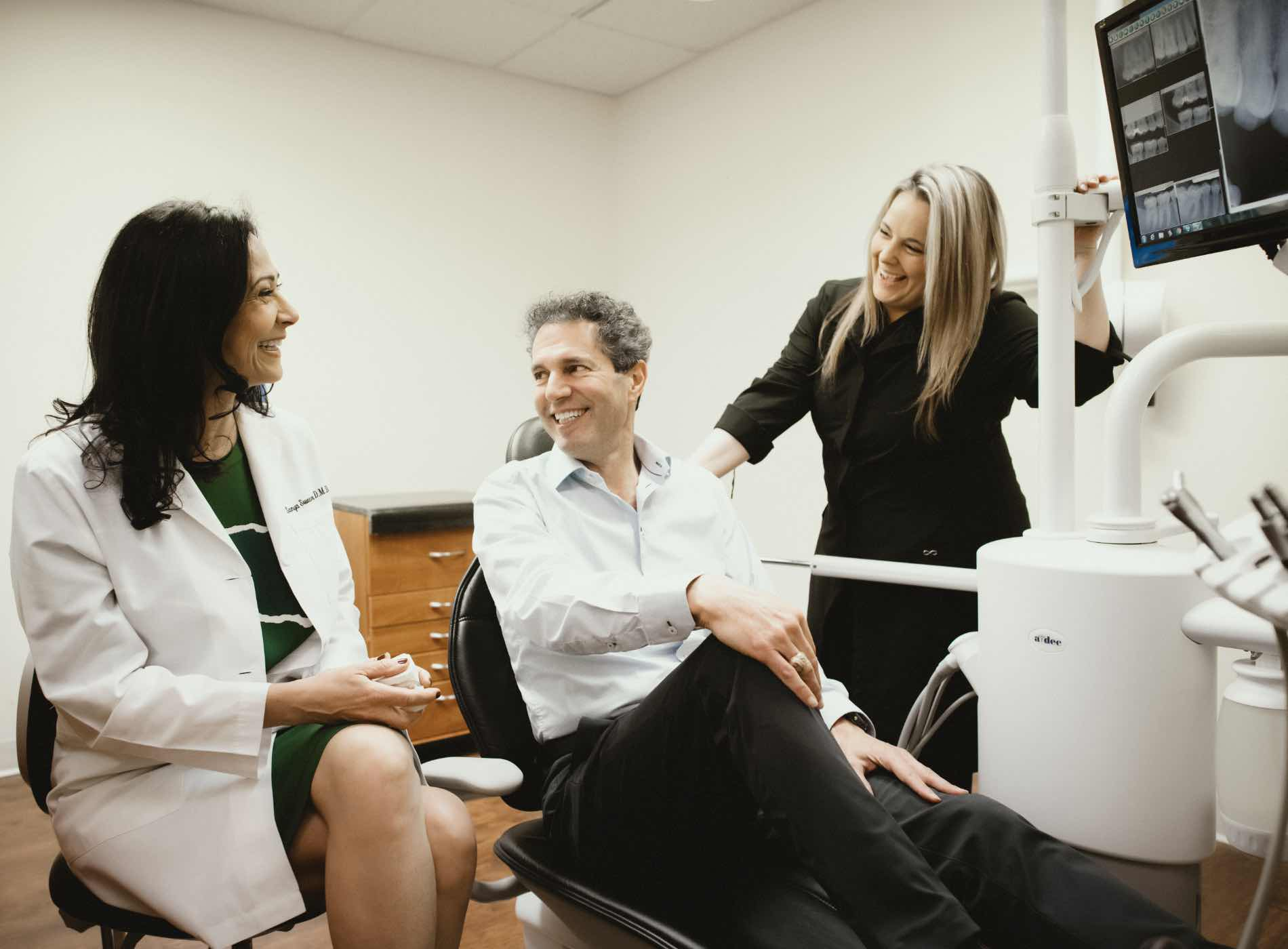 Photo of Riverton dentist, Dr. Sweeny-Fonesca talking to a patient sitting in a dental chair