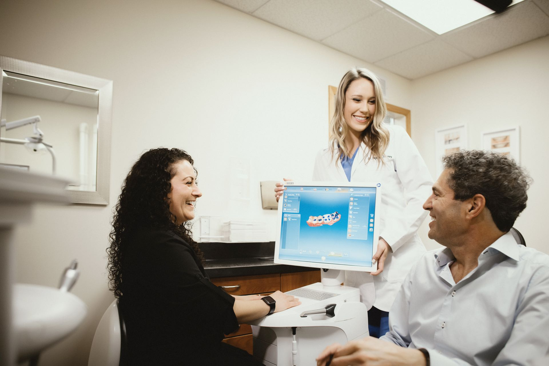 Photo of a dentist and a patient looking at a 3-d dental scan