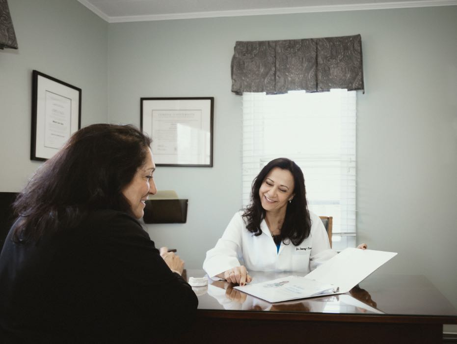 Photo of Riverton cosmetic dentist, Dr. Sweeney-Fonesca sharing a treatment plan with a patient