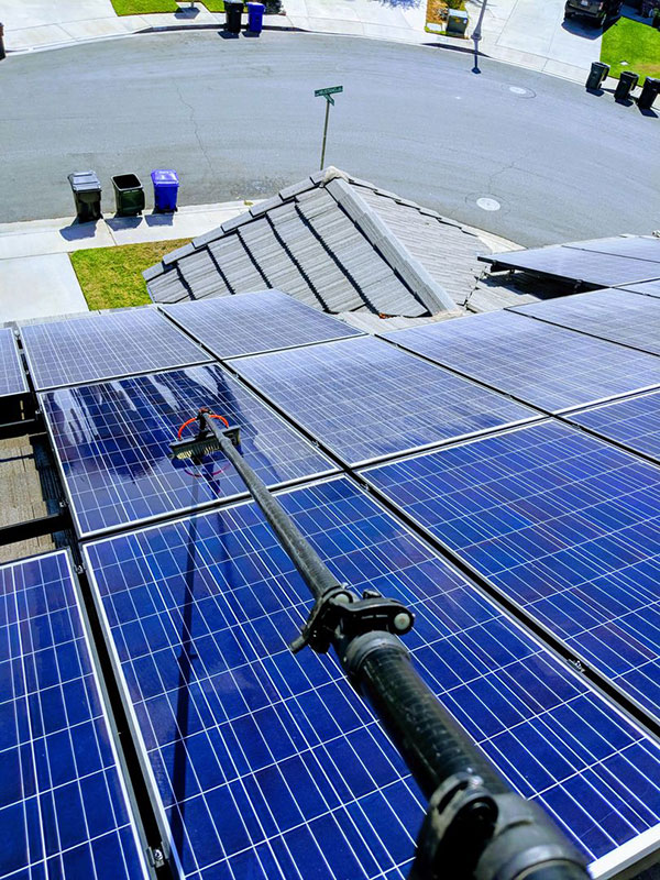Roof solar panels being cleaned by pure water system.