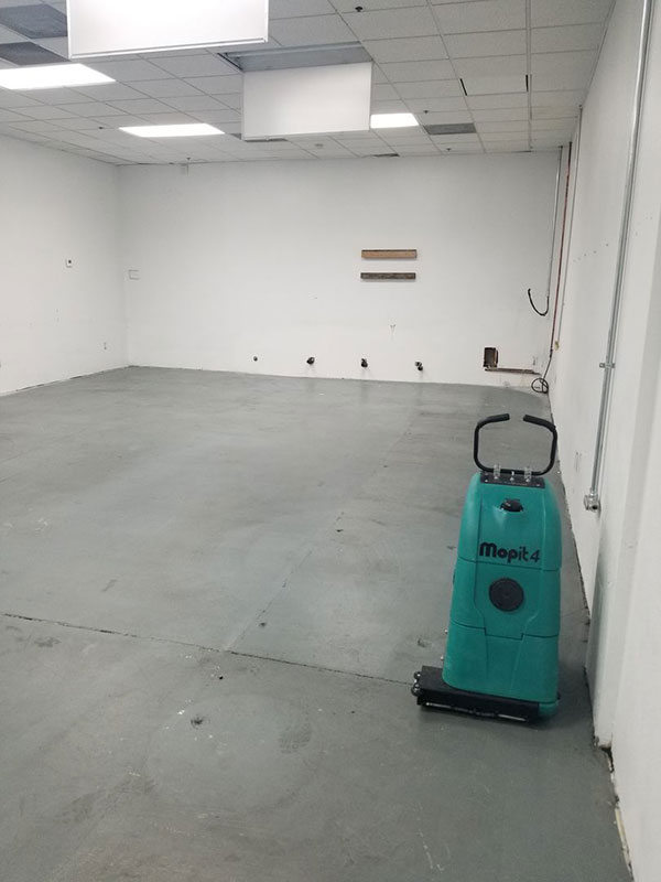 A floor buffer machine in a commerce area.