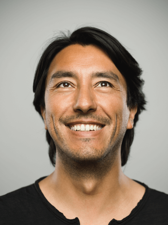 Smiling man looking upward
