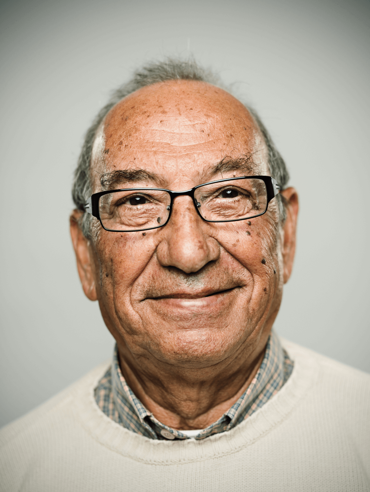 Smiling old man with glasses