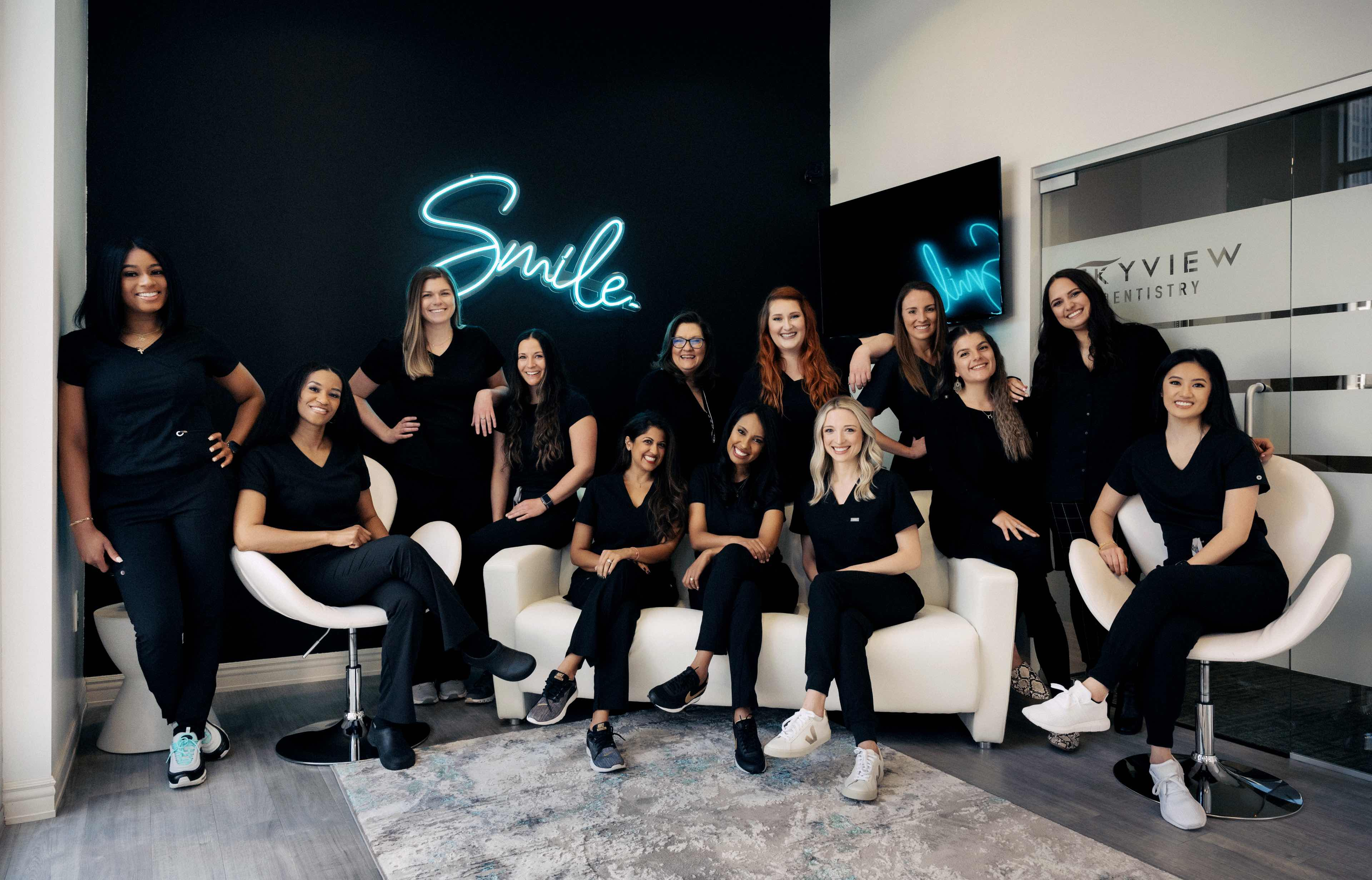 Photo of the Skyview Dentistry team, inside their office in downtown Charlotte