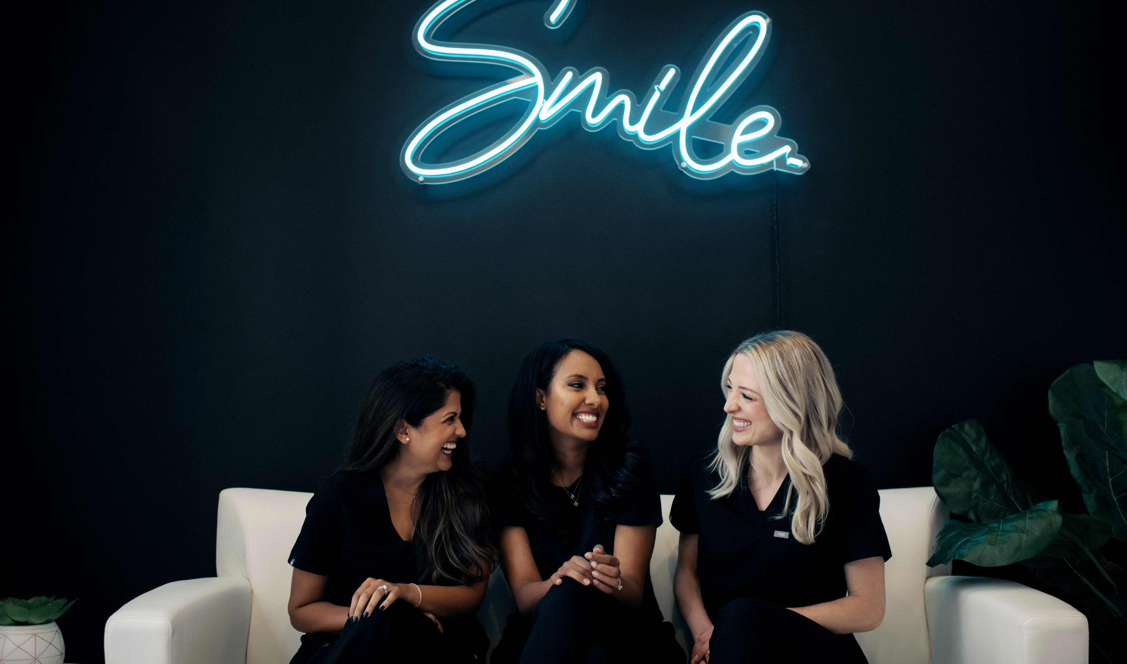 Photo of three dental team members