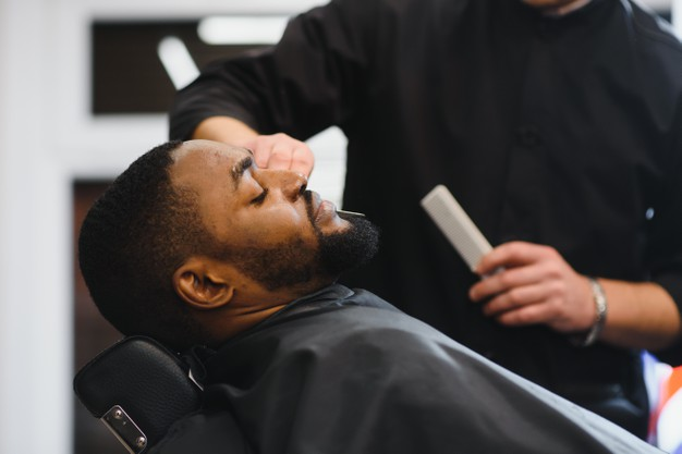 Man relaxing and having his hair cut