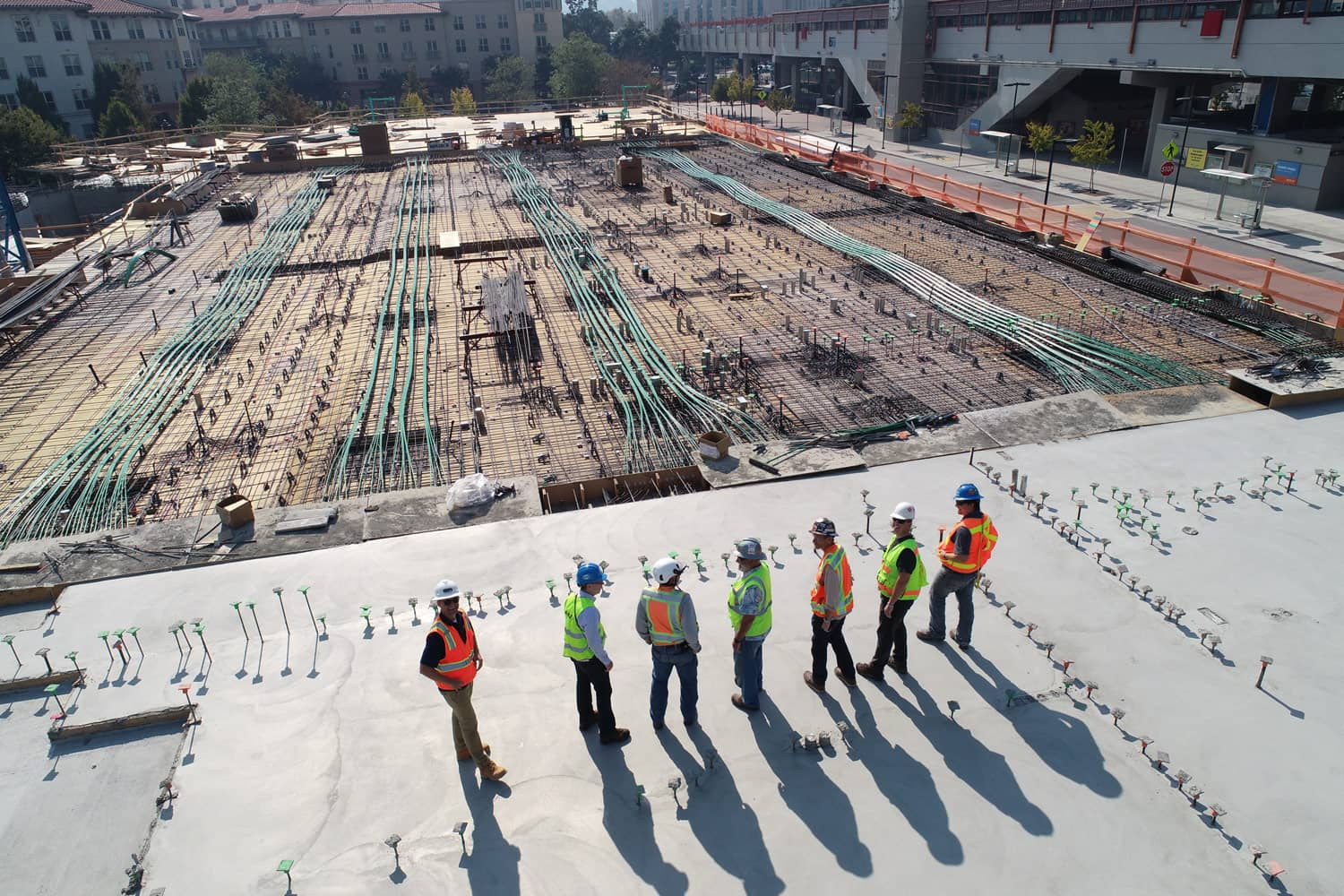 Wide view shoot with group of construction worker looking into a worksite