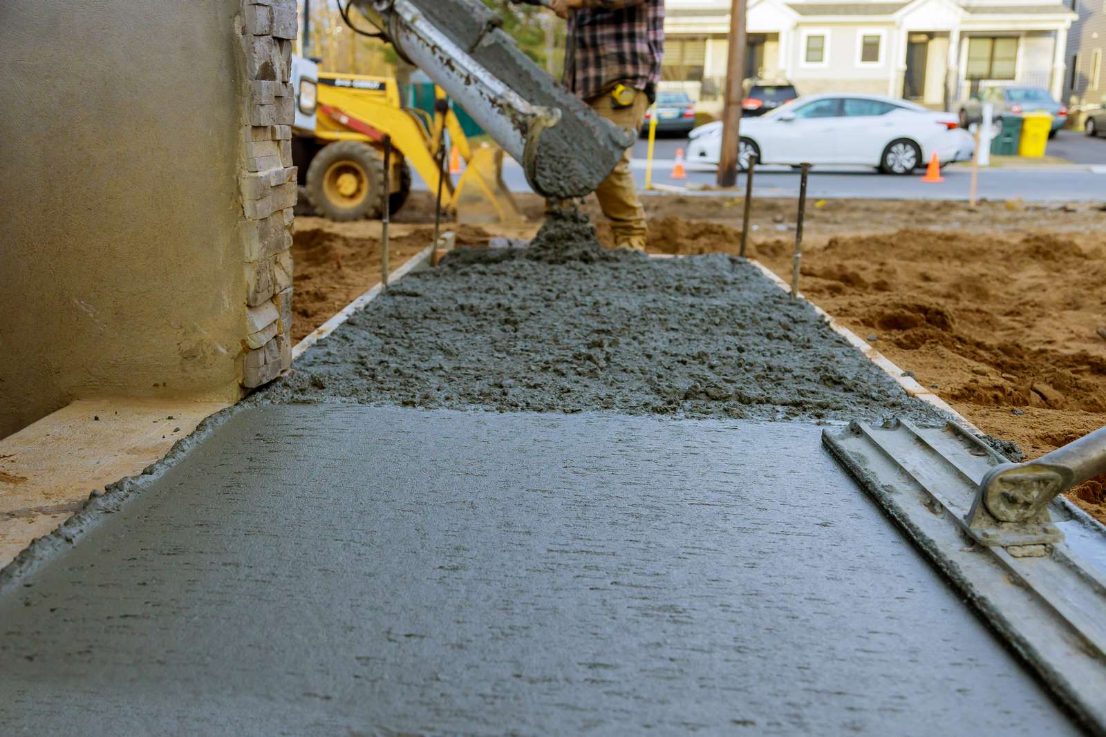 Workers pouring cement